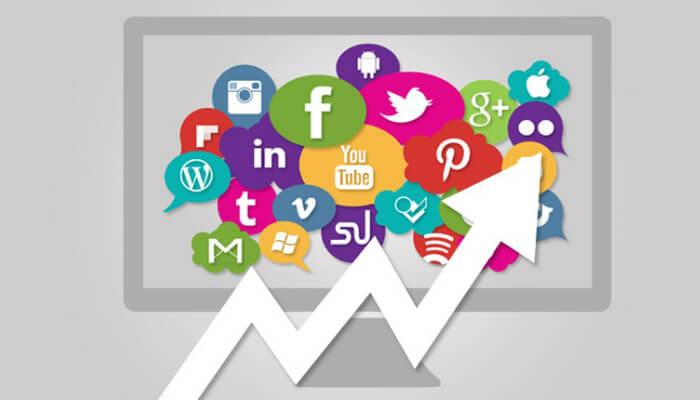 Ilustração de tela de computador com logos de várias redes sociais e seta para cima, representando o Google Trends