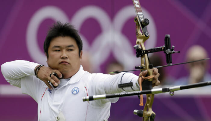 Atleta olímpico de tiro com arco, representando o remarketing para Google Ads